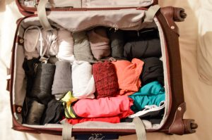 Roll Clothes in the Bottom of Your Suitcase